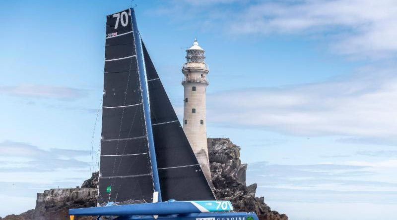 Skippered by Ned Collier Wakefield, Tony Lawson's MOD70 Concise is the first boat to round the Fastnet Rock © Rolex/Kurt Arrigo